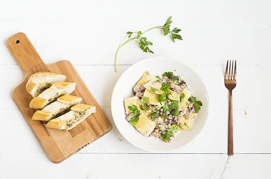 Kaasravioli met champignonsaus